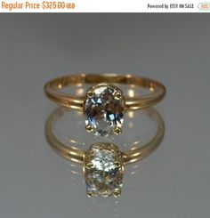 DEADsy LAST GASP SALE Topaz Engagement Ring // by lagnole on Etsy