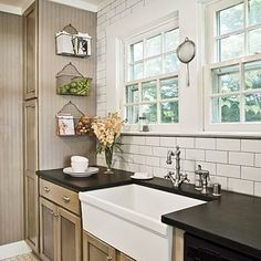 Google Image Result for http://i-cdn.apartmenttherapy.com/uimages/kitchen/2009_05_08-greykitchen.jpg.  white subway tile with gray grout.