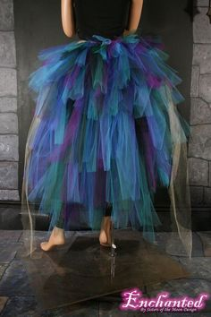 for peacock costume--over black leotards, with peacock feathers in hair.: