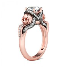 Jeulia Two Tone Round Cut Created White Sapphire Skull Ring - it's rose gold and black with skulls and a diamond, what more could a girl want??