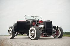 LUV the headlights and period correct hot rod touches on this1931 Ford Hot Rod called 'Ol' Jiggles'. A real 1950's California hot rod with steel wheels, hubcaps, trim rings, whitewalls, flathead V-8 with Edelbrock heads, Offenhauser intake with triple Stromberg 97s, a Borg-Warner T10 4-speed, Buick drum brakes, beehive oil filter, tube shocks, Auburn dashboard, Duesenberg tachometer, Wood Lites, folding windshield, Deuce radiator shell...