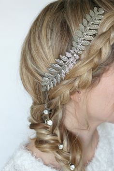 I love wearing my hair in a cute  braid no matter what the season—but when it comes to the holidays, I like to take this classic hairstyle to the next level by glamming it up a bit! To create this snow-kissed beauty look, I incorporated little touches that remind me of winter—like silver, rhinest...