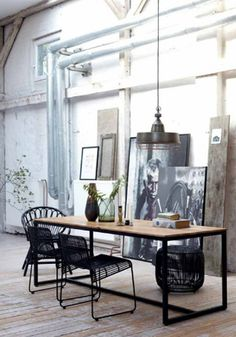 FORM table by House Doctor at www.bodieandfou.com . The geometrical language of this table is created through the use of the thick black frame as its base and is softened by the timber table top and the more muted hues of the rest of the room, perfect industrial chic #table #homeoffice #atthewritingdesk