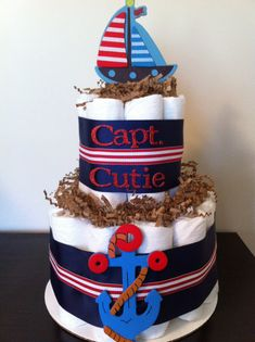 Great birthday ideas kids!!! Hes going to be 1 year old but he needs diapers!! lol! GAvin is a size 3!!!!!!!!!! Nautical Diaper Cake Boy Baby Shower by BabeeCakesBoutique on Etsy, $25.00