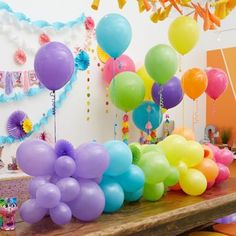 Rainbow garland centerpiece displayed across a long rectangular wooden classroom table with helium balloons attached. 21 Balloons, Rainbow Balloons, Balloon Display, Balloon Garland, Balloon Table Centerpieces, Centerpiece Ideas, Table Garland, Rainbow Birthday Party, Party Themes