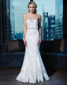 A luxurious beaded sweetheart neckline and beaded trim at the natural  waistline accent this layered lace fit and flare. Satin and beaded  buttons cover the back zipper and continue to the end of the chapel  length train.