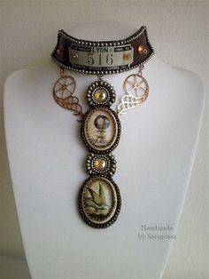 "Necklace |  Saragossa Jewellery Designs.  ""Hot Air Balloon Journey"".    Steampunk bead embroidery with balloon cameo and copper gears."