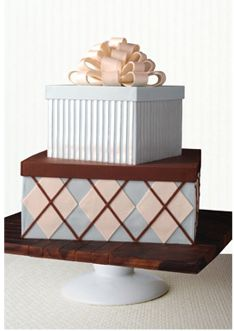 Argyle pattern stacked gift boxes in blue, brown and ivory by Mark Joseph Cakes
