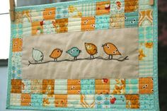 Patchwork mini quilt with free motion bird applique