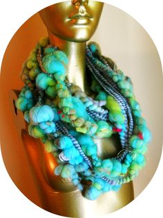 http://www.spinartiste.com/wp-content/uploads/2012/10/AC-DA-Bubbly-Blue-Neck-Piece-.jpg