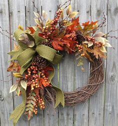 This fall wreath is the perfect harvest time decoration! A gorgeous wired green basket weaver burlap ribbon is the focal point. Realistic leaves,
