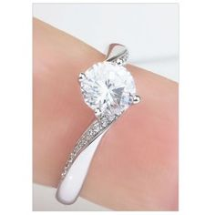 Burlesque 4 Claw Twist Engagement Ring Shown On the Finger. Twisted shoulders feature fine 1mm grain set diamonds contoured towards the four claw setting.