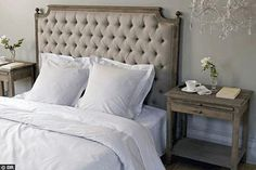 Love those bed side tables, crisp white linen and the colour tones