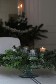 simple and lovely, greens with candles on a footed dish