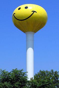 "There are 22 towns with tall ""smiley face"" water towers: Eagle & - Oconto, Wisconsin - Aroma Park, Atlanta, Makanda, Thomasboro, & Watseka, Illinois - Calumet City, Illinois with ""Mr. & Mrs. Smiley"" - Adair, Iowa - Ashley, Indiana - Flushing, Fruitport, Ironwood, Millington, Wells & West Branch, Michigan - Spring Park & Waite Park, Minnesota - Axtell & Gibbon, Nebraska - Longport, New Jersey - Columbia, South Carolina"