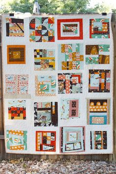 Love this playful scrap-like take on a quilt made with quilt blocks.