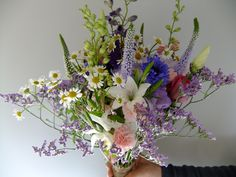 A pretty country wedding bouquet of cottage garden flowers in muted clolours