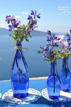 #centerpiece DIY Santorini Wedding  See the full post here:http://tietheknotsantorini.com/blog/diy-santorini-wedding-decor-blue-purple