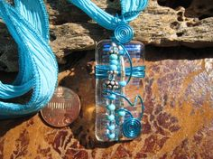 LIGHT TURQUOISE dichroic glass pendant with ribbon wire wrapped $34 by Silvia Engel