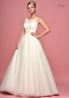 I tried this on!! Ball gown with scoop neck illusion top. Lou Lou Bridal.