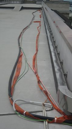 Installing 11,000 volt cables into new roof trunking (tidy-up)