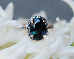 Blue Green sapphire Rose gold engagement ring. Engagement ring by Eidelprecious. This ring features a 3.7ct oval sapphire. The color is gorgeous deep peacock green with blue flashes , SI, heated. The sapphire is very beautiful and clean, tones of sparkles! The sapphire displays color change and l