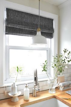 New Roman Shades in the Kitchen - Nesting With Grace We just got new Roman Shades in our kitchen. We went with a gray and mounted them inside for a finished look. See my tips on hoe to measure for Roman Shades Contemporary Window Treatments, Kitchen Window Coverings, Home Decor Kitchen, Kitchen Colors, House, Home, Kitchen Window, Roman Shades Kitchen, Kitchen Window Treatments