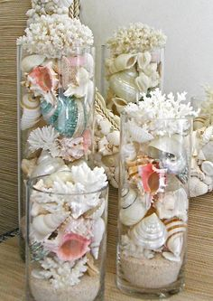 Add teardrop lights and it's gorgeous. Beach Decor - Seashells, Coral and Starfish in Glass Cylinders for our beach bedroom .maybe just one or two here or there. Seashell Crafts, Beach Crafts, Diy Crafts, Seashell Decorations, Seashell Centerpieces, Coral Decorations, Coastal Style, Coastal Decor, Coastal Living