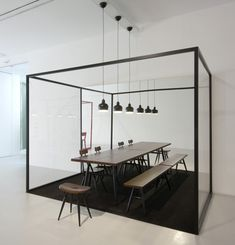 Dining black frame. Artek in Milan.