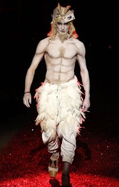 A model displays a creation by British designer John Galliano as part of his Fall/Winter 2009/10 men's collections during Paris Fashion Week January 23, 2009