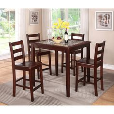 Enhance your dining area with this five-piece dining set featuring clean and simple lines on the espresso-finished hardwood. This attractive set is topped with gorgeously styled imitation marble for a fresh look.