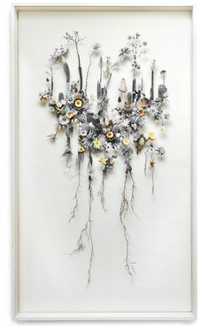 Netherlands-based artist Anne ten Donkelaar designs shadow-boxed collages of intricate floralscapes