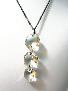 Reclaimed Beauty Crystal trio Necklace- Upcycled antique chandelier prisms  - antiqued brass. $35.00, via Etsy.