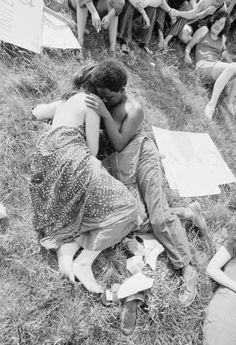 27 Jun 1971 --- Interracial couple embracing as demonstrators gather for the second Gay Pride Parade in New York City