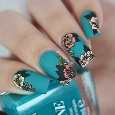 Dark teal nail polish with muted pink and yellow stamped flowers by @glitterfingersss