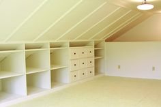 Anna Maria Horner's sewing studio  I love the shelves!  Good use of the low area of the sloped ceiling.
