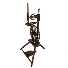An early 19th century Scottish, possibly Renfrewshire oak and mahogany spinning wheel.     The spinning wheel has a bronze wheel with turned mahogany spokes and is decorated with turned ivory detail.     Height 95cm (37.4 inches)   Width 53cm (20.9 inches)   Depth 48cm (19 inches)