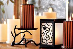 Gaia Branch Pillar Holder - Bring a unique, earthy look indoors with this artistically rendered tree branch pillar holder. Cast metal with black powdercoat finish. #PartyLite #candles