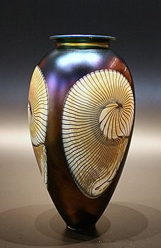Fusion glass    (This is one of several magnificent works of art in ceramic that illustrate spirals or swirls).