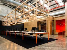 Australia's Unit B4 uses large plywood boxes to house its meeting rooms.