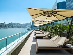 Kerry Hotel Hong Kong With pride of place on Kowloons vibrant waterfront at the heart of Hung Hom Bay Kerry Hotel Hong Kong is an urban lifestyle resort offering guests unique dining concepts extraordinary spaces and. Big Bay, Victoria Harbour, Harbor View, Hotel S, New Builds, Architecture, Sun Lounger, Hong Kong, Patio