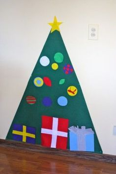 The little kids have their own tree to do with whatever they please! The original idea came from Johnny In a Dress...