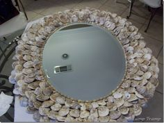 A how to on making an oyster shell mirror.....lots of liquid nails!!!