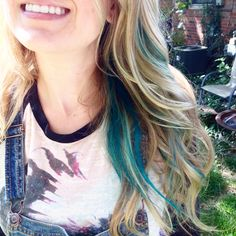 Long blonde wavy blue teal green peekaboo hair style