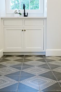 cement tiles, black & white, laundry room, black pull-down faucet