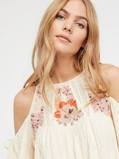 Fast Times Top | All cotton cold shoulder top featuring beautiful embroidery and embellishments in a floral design.      * Adjustable ties at the sleeves and neckline    * Soft, semi-sheer fabrication    * Cute crochet trims