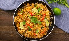 Delicious chicken pad thai being prepared in a frying pan