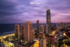 Surfers Paradise, Gold Coast, Queensland, Australia. The tall building right of centre is the Q1 (Queensland Number One) at 9 Hamilton Ave.The white building left of centre has a neon sign on top that says Hotel Grand Chancellor (which is now the Novotel Surfers Paradise) located on Surfers Paradise Blvd. & Hanlan St. https://www.google.ca/maps/place/Novotel+Surfers+Paradise/@-28.0043154,153.4267776,17z/data=!4m5!3m4!1s0x6b910572b61991e9:0xace24c5212796a43!8m2!3d-28.002563!4d153.428741