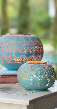 Add a dash of color with our Isla Lanterns. The three lanterns feature a rich turquoise patina on the outside, gold finish on the inside, and a metal-cut pattern inspired by Moroccan tiles. #Moroccandecor