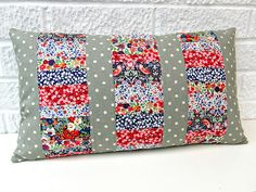 Finished cushion 2 by Very Berry Handmade, via Flickr love how the grey stripes even out the business of the florals